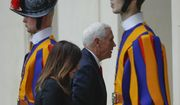 U.S. Vice President Mike Pence and his wife Karen walk past Vatican Swiss Guards as they arrive at the San Damaso courtyard at the Vatican ahead of their private audience with Pope Francis, Friday, Jan. 24, 2020. (AP Photo/Domenico Stinellis)