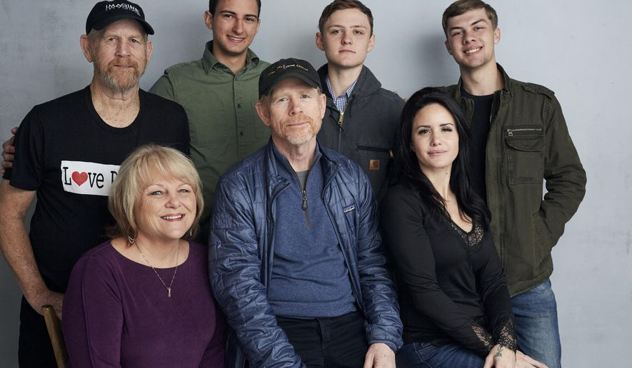 """Steve (Woody) Culleton, from left, Bryson Groh, Zach Boston, Brandon Burke, Michelle John, from bottom right, director Ron Howard and Carly Jean Ingersoll pose for a portrait to promote the film """"Rebuilding Paradise"""" at the Music Lodge during the Sundance Film Festival on Friday, Jan. 24, 2020, in Park City, Utah. (Photo by Taylor Jewell/Invision/AP)"""