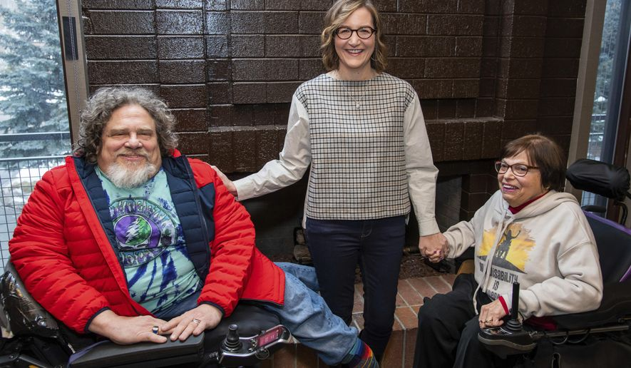 """Co-directors Jim LeBrecht, left, and Nicole Newnham join one of the subjects, Judith Heumann, from the documentary """"Crip Camp"""" to pose for a portrait during the 2020 Sundance Film Festival on Friday, Jan. 24, 2020, in Park City, Utah. (Photo by Charles Sykes/Invision/AP)"""