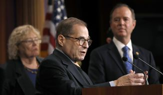 House impeachment manager Rep. Jerrold Nadler, D-N.Y., center, stands with impeachment managers Rep. Zoe Lofgren, D-Calif., left, and Rep. Adam Schiff, D-Calif., during a news conference at the Capitol in Washington during the impeachment trial of President Donald Trump on charges of abuse of power and obstruction of Congress, Saturday, Jan. 25, 2020. (AP Photo/Julio Cortez) **FILE**