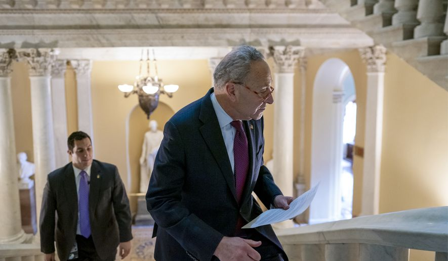 Senate Minority Leader Chuck Schumer, D-N.Y., heads to talk to reporters about Democrats' arguments in the impeachment trial of President Donald Trump on charges of abuse of power and obstruction of Congress, in Washington, Friday, Jan. 24, 2020. (AP Photo/J. Scott Applewhite)