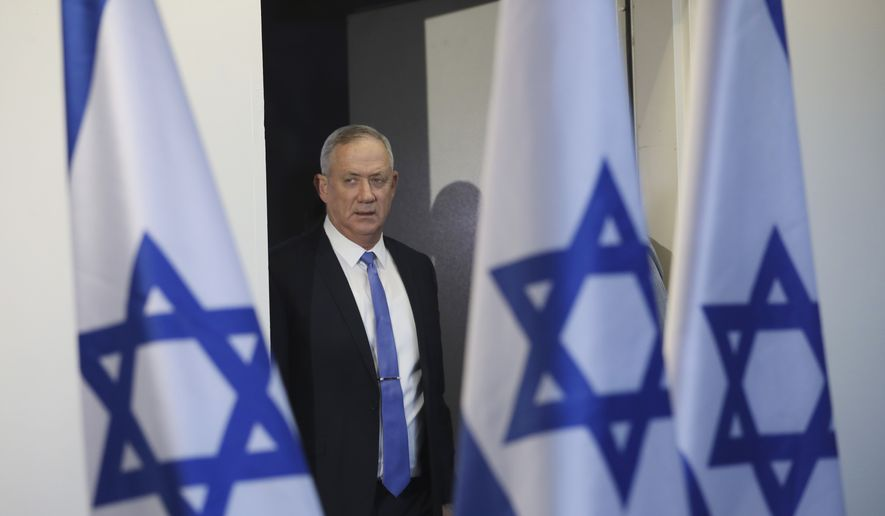 In this Nov. 20, 2019, file photo, Blue and White party leader Benny Gantz arrives to address media in Tel Aviv, Israel. (AP Photo/Oded Balilty, File)