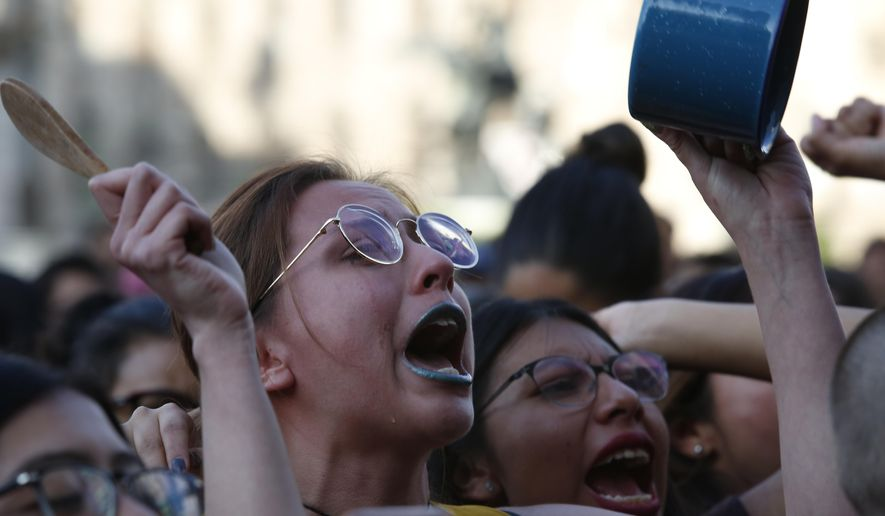 Women protest against the latest murder of two women, in Mexico City, Saturday, Jan. 25, 2020. During the past couple of weeks two women activists, attorney Yunuen Lopez Sanchez and Isabel Cabanillas de la Torre where both murdered by unknown assailants. (AP Photo/Ginnette Riquelme)