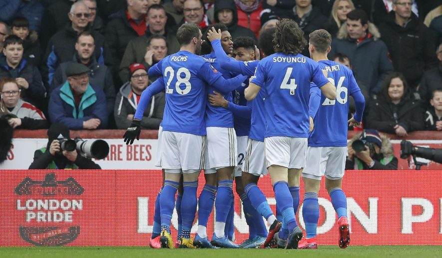 Leicester's players celebrate their side's first goal, scored by Kelechi Iheanacho, during the English FA Cup fourth round soccer match between Brentford FC and Leicester City at Griffin Park stadium in London, Saturday, Jan. 25, 2020. (AP Photo/Kirsty Wigglesworth)