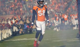 FILE - In this Dec. 29, 2019 file photo, Denver Broncos outside linebacker Von Miller reacts before an NFL football game against the Oakland Raiders in Denver.  Miller's read on the Super Bowl is this: Patrick Mahomes and the Kansas City Chiefs will be a handful. The Broncos Pro Bowl pass rusher knows that from first-hand experience. But he's predicting a San Francisco 49ers win.(AP Photo/Jack Dempsey)