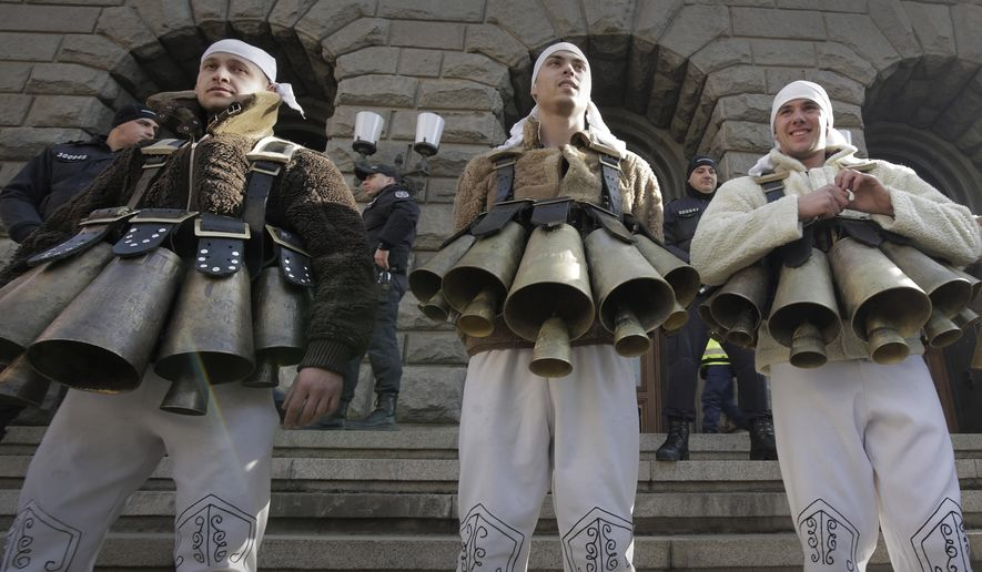 Bulgarian traditional Mummers protest against the alleged mismanagement of Bulgarian government that has led to a water crisis in Sofia, on Saturday, Jan.25, 2019.  Citizens have been protesting for weeks, holding authorities accountable for bringing their city to the verge of what they are calling a humanitarian crisis. (AP Photo/Valentina Petrova)