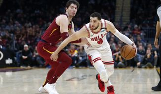 Chicago Bulls' Zach LaVine (8) drives against Cleveland Cavaliers' Cedi Osman in the second half of an NBA basketball game, Saturday, Jan. 25, 2020, in Cleveland. (AP Photo/Ron Schwane)