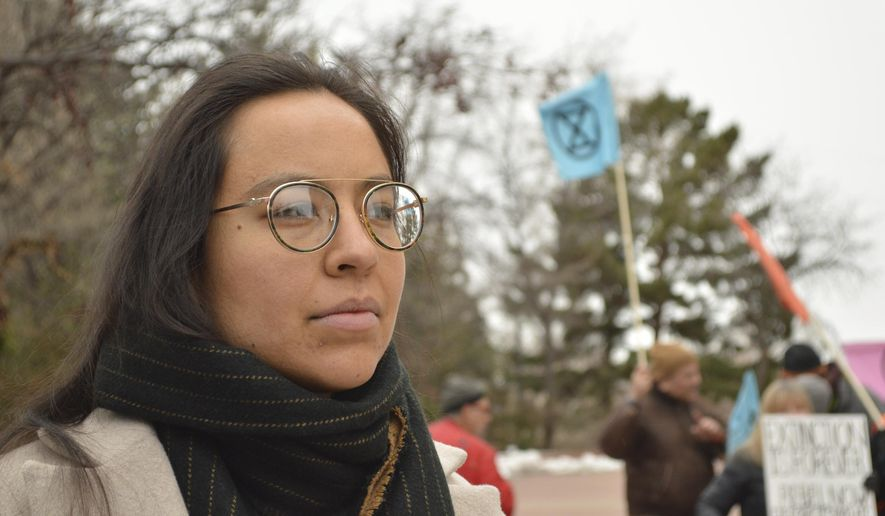In this Tuesday, Jan. 21, 2020, photo, Lyla June Johnston appears during a weeklong fast outside the New Mexico Statehouse in Santa Fe, N.M., to protest for action on climate change. Johnston is campaigning for the Democratic primary nomination to the state House against Rep. Brian Egolf of Santa Fe. Legislative elections and ideological divisions among Democrats are looming over major initiatives backed by Gov. Michelle Lujan Grisham on gun safety, recreational marijuana and pension reform. (AP Photo/Russell Contreras)
