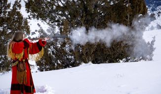 In this Saturday, Jan. 18, 2020 photo, Alyssa Stansfield shoots her muzzleloader at the Willy Wapiti's Smoke Pole Biathlon at Hardware Ranch, near Hyrum, Utah. (Jackson Wilde/The Herald Journal via AP)