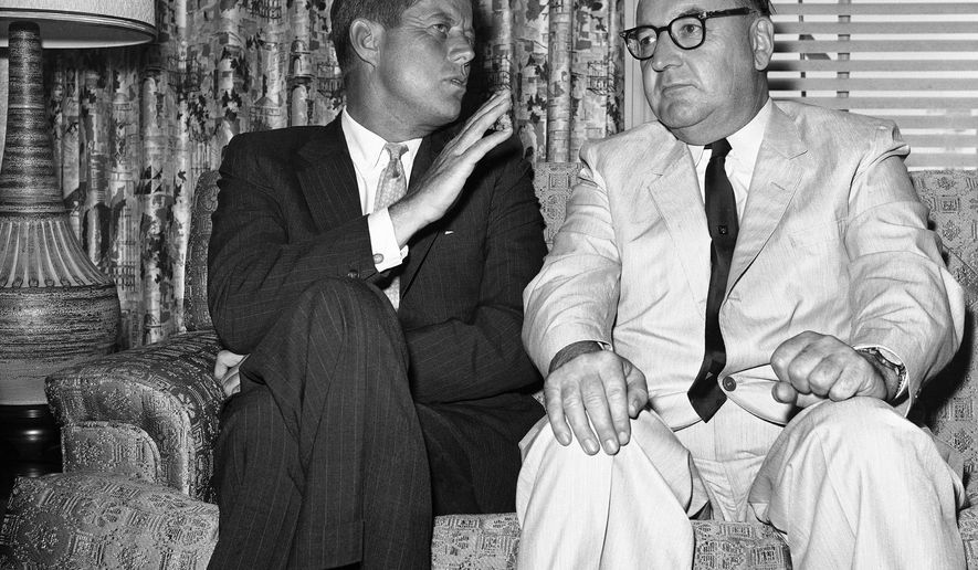 "FILE - In this July 10, 1960, file photo, Sen. John F. Kennedy of Massachusetts gestures during his meeting with California Gov. Edmund G. (Pat) Brown in Los Angeles. Former California Gov. Jerry Brown wants to know who is trying to sell his father's memorabilia related to the assassination of President John F. Kennedy. Private letters and other items that had belonged to Edmund G. ""Pat"" Brown when he was California governor are being offered by the auction house Sotheby's, which estimates the value at $20,000 to $30,000.   (AP Photo, File)"