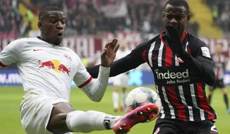 Frankfurt's Evan N'Dicka, right,  and Leipzig's Nordi Mukiele fight for the ball during a German Bundesliga soccer match between Eintracht Frankfurt and RB Leipzig in Frankfurt, Germany, Saturday, Jan.25, 2020. (Thomas Frey/dpa via AP)