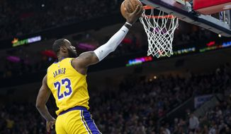 Los Angeles Lakers' LeBron James goes up for the shot during the first half of an NBA basketball game against the Philadelphia 76ers, Saturday, Jan. 25, 2020, in Philadelphia. (AP Photo/Chris Szagola) ** FILE **