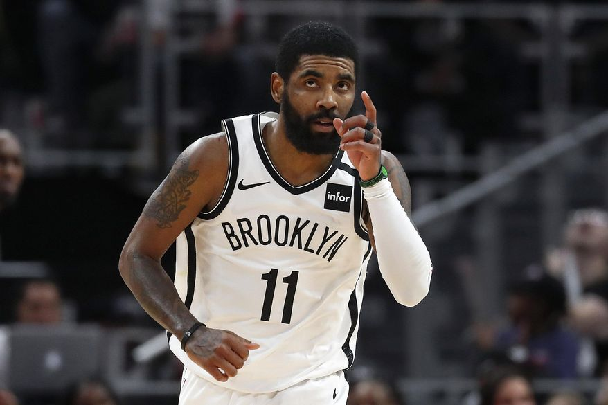 Brooklyn Nets guard Kyrie Irving (11) reacts after a basket in overtime of an NBA basketball game against the Detroit Pistons in Detroit, Saturday, Jan. 25, 2020. Brooklyn won 121-111. (AP Photo/Paul Sancya)
