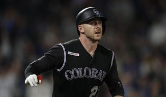 FILE - This Sept. 28, 2019 file photo shows Colorado Rockies shortstop Trevor Story (27) in the 10th inning of a baseball game in Denver.  Story and the Colorado Rockies have agreed to a $27.5 million, two-year contract that avoids an arbitration hearing, according to a person familiar with the deal. The person spoke to The Associated Press on condition of anonymity Friday, Jan. 25, 2020 because the agreement was pending a physical and had not been announced. (AP Photo/David Zalubowski)