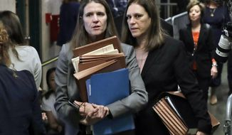 Assistant District Attorneys Meghan Hast, left, and Joan Illuzzi leave the Harvey Weinstein rape trial during the lunch break, Thursday, Jan. 23, 2020, in New York. (AP Photo/Richard Drew)