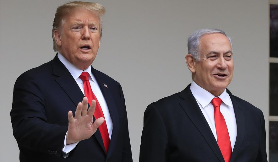 In this March 25, 2019, file photo, President Donald Trump welcomes visiting Israeli Prime Minister Benjamin Netanyahu to the White House in Washington. A blueprint the White House is rolling out to resolve the decades-long conflict between the Israelis and Palestinians is as much about politics as it is about peace. President Donald Trump said he would likely release his long-awaited Mideast peace plan a little before he meets Tuesday with Israeli Prime Minister Benjamin Netanyahu and his main political rival Benny Gantz. (AP Photo/Manuel Balce Ceneta, File)