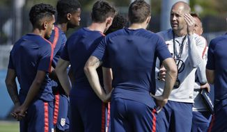 Gregg Berhalter, right, head coach of the U.S. Men's National Soccer team, instructs some of his players during drills Wednesday, Jan. 8, 2020, in Bradenton, Fla. The team moved its training camp from Qatar to Florida in the wake of Iran's top military commander being killed during a U.S. airstrike in the Middle East. (AP Photo/Chris O'Meara)