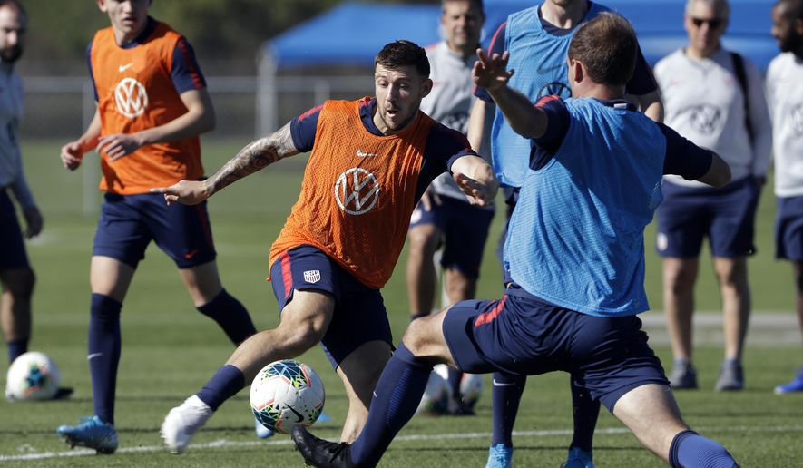 Paul Arriola, center, a forward on the U.S. Men's National Soccer team, kicks the ball during a scrimmage Wednesday, Jan. 8, 2020, in Bradenton, Fla. The team moved its training camp from Qatar to Florida in the wake of Iran's top military commander being killed during a U.S. airstrike in the Middle East. (AP Photo/Chris O'Meara) **FILE**