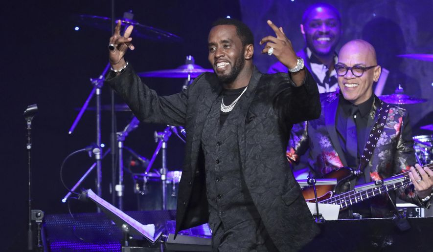 Sean Combs walks on stage to accept the 2020 Industry Icon award at the Pre-Grammy Gala And Salute To Industry Icons at the Beverly Hilton Hotel on Saturday, Jan. 25, 2020, in Beverly Hills, Calif. (Photo by Willy Sanjuan/Invision/AP)