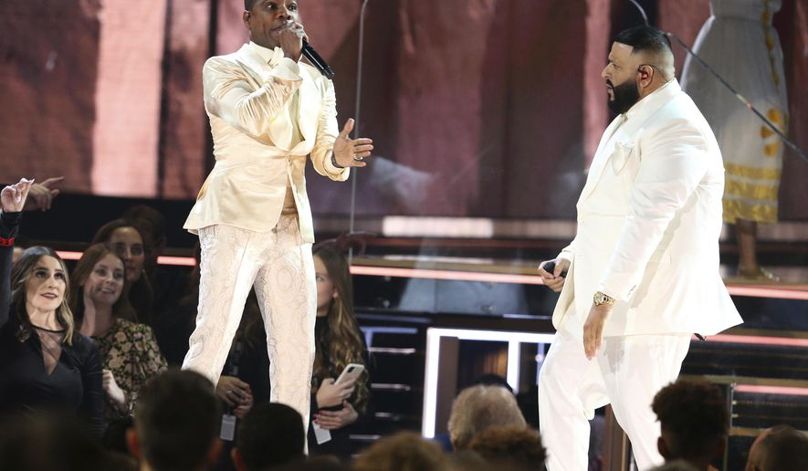 Kirk Franklin, left, and DJ Khaled perform during a tribute in honor of the late Nipsey Hussle at the 62nd annual Grammy Awards on Sunday, Jan. 26, 2020, in Los Angeles. (Photo by Matt Sayles/Invision/AP)