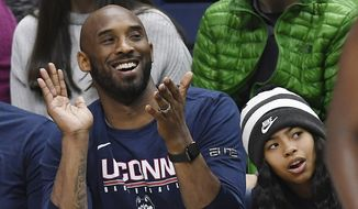 In this March 2, 2019, file photo, Kobe Bryant and his daughter Gianna watch the first half of an NCAA college basketball game between Connecticut and Houston in Storrs, Conn. Bryant, the 18-time NBA All-Star who won five championships and became one of the greatest basketball players of his generation during a 20-year career with the Los Angeles Lakers, died in a helicopter crash Sunday, Jan. 26, 2020. Gianna also died in the crash. (AP Photo/Jessica Hill)