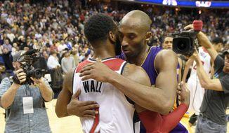 Los Angeles Lakers forward Kobe Bryant, right, hugs Washington Wizards guard John Wall (2) after an NBA basketball game, Wednesday, Dec. 2, 2015, in Washington. The Lakers won 108-104. (AP Photo/Nick Wass) ** FILE **