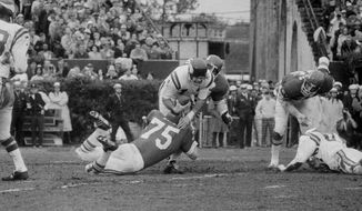 Minnesota Viking quarterback Joe Kapp is hauled down by Kansas City Chiefs Jerry Mays (75) as another Chief moves in from the rear during the first half of Super Bowl IV, Jan. 11, 1970, in New Orleans. (AP Photo/JS) **FILE**