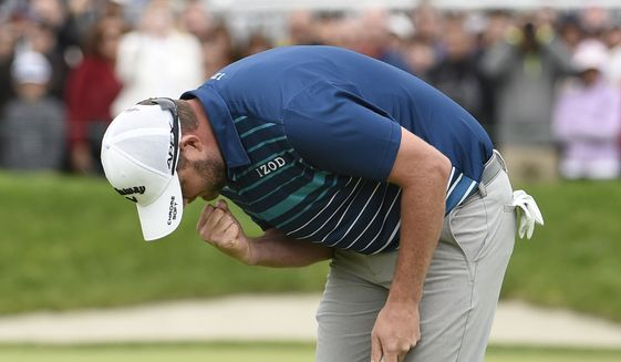 Marc Leishman, of Australia, pumps his fist on the 18th hole after winning the Farmer's Insurance Open at the Torrey Pines Golf Course, Sunday Jan. 26, 2020, in San Diego. (AP Photo/Denis Poroy)