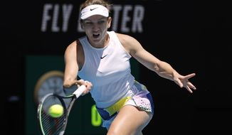 Romania's Simona Halep makes a forehand return to Belgium's Elise Mertens during their fourth round singles match at the Australian Open tennis championship in Melbourne, Australia, Monday, Jan. 27, 2020. (AP Photo/Andy Wong)