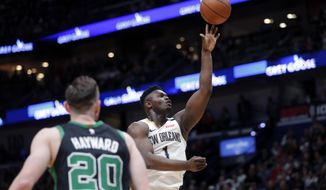 New Orleans Pelicans forward Zion Williamson (1) shoots in front of Boston Celtics forward Gordon Hayward (20) in the first half of an NBA basketball game in New Orleans, Sunday, Jan. 26, 2020. (AP Photo/Gerald Herbert)