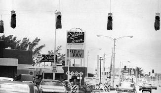 This June 29, 1970 photo, shows new traffic lights, above, that are being installed in front of of Sears Town at U.S. 1 and Sunrise Blvd., in Fort Lauderdale, Fla. Sears Town, the first of its kind in the South, introduced a cutting-edge concept to Fort Lauderdale: the strip mall. (South Florida Sun-Sentinel via AP)