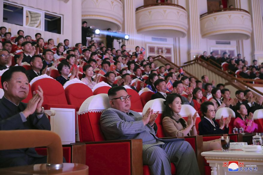 """In this Saturday, Jan. 25, 2020, photo provided by the North Korean government, North Korean leader Kim Jong Un, center, claps with his wife Ri Sol Ju, third from right, and his aunt Kim Kyong Hui, second from right, as they attend a concert celebrating Lunar New Year's Day in Pyongyang, North Korea. Independent journalists were not given access to cover the event depicted in this image distributed by the North Korean government. The content of this image is as provided and cannot be independently verified. Korean language watermark on image as provided by source reads: """"KCNA"""" which is the abbreviation for Korean Central News Agency. (Korean Central News Agency/Korea News Service via AP)"""