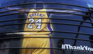 FILE - In this April 13, 2016, file photo, a giant banner congratulating Kobe Bryant is draped around Staples Center before his last NBA basketball game in downtown Los Angeles. Bryant, the 18-time NBA All-Star who won five championships and became one of the greatest basketball players of his generation during a 20-year career with the Los Angeles Lakers, died in a helicopter crash Sunday, Jan. 26, 2020. (AP Photo/Richard Vogel) ** FILE **