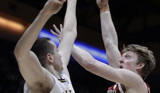 Stanford's James Keefe, right, shoots against California's Grant Anticevich (15) in the first half of an NCAA college basketball game Sunday, Jan. 26, 2020, in Berkeley, Calif. (AP Photo/Ben Margot)