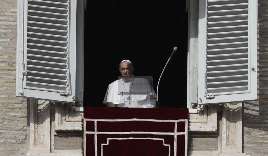 Pope Francis approaches his studio window overlooking St. Peter's Square to deliver the Angelus noon prayer at the Vatican, Sunday, Jan. 26, 2020. (AP Photo/Gregorio Borgia)