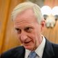 D.C. Council member Jack Evans speaks to a reporter in the Council Chambers before a Committee of the Whole Meeting at the Wilson Building in Washington on Feb. 4, 2014. (Andrew Harnik/The Washington Times) **FILE**