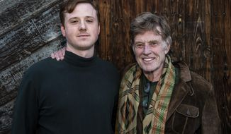 """Director Dylan Redford, left, and his grandfather Robert Redford pose for a portrait to promote """"Omniboat: A Fast Boat Fantasia"""" during the 2020 Sundance Film Festival on Sunday, Jan. 26, 2020, in Park City, Utah. (Photo by Charles Sykes/Invision/AP)"""