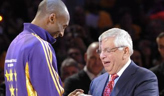 National Basketball Association Commissioner David Stern, right, gives Los Angeles Lakers guard Kobe Bryant his championship ring during a ceremony before the start of an NBA basketball game against the Los Angeles Clippers, Tuesday, Oct. 27, 2009, in Los Angeles. (AP Photo/Gus Ruelas) **FILE**