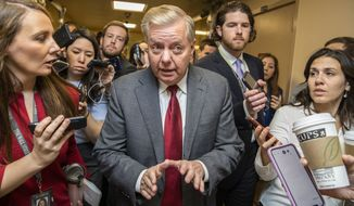 Sen. Lindsey Graham, R-S.C., speaks to reporters as he arrives at the Capitol in Washington, Monday, Jan. 27, 2020, during the impeachment trial of President Donald Trump on charges of abuse of power and obstruction of Congress. (AP Photo/Manuel Balce Ceneta)