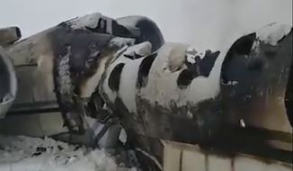This photo provided by Tariq Ghazniwal shows an aircraft that crashed in eastern Afghanistan on Monday, Jan. 27, 2020. The U.S. military says it is investigating reports of an airplane crash in Taliban-controlled territory in Afghanistan. U.S. Army Maj. Beth Riordan, a spokeswoman for U.S. Central Command, said that it remained unclear whose aircraft was involved in the crash.  (Tariq Ghazniwal via AP)