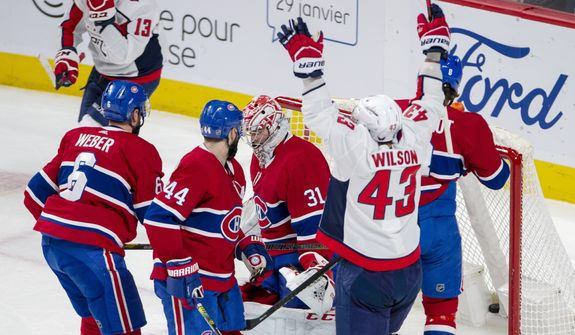 Washington Capitals right wing Tom Wilson (43) reacts after scoring against Montreal Canadiens goaltender Carey Price (31) during first period NHL hockey action Monday, Jan. 27, 2020 in Montreal. (Ryan Remiorz/The Canadian Press via AP)