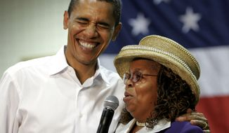 """In this Oct. 6, 2007, file photo, then-presidential hopeful Sen. Barack Obama, D-Ill., left, shares a laugh with Greenwood County, S.C., Council Woman, Edith Childs, right, whom he credited with giving him the idea for his popular """"Fire It Up,"""" campaign chant in a packed gymnasium at South Aiken High School, in Aiken, S.C. Childs, the woman credited with popularizing a memorable slogan and chant that epitomized the 2008 campaign of then-Sen. Barack Obama has endorsed Tom Steyer's presidential bid. (AP Photo/Brett Flashnick, File)"""