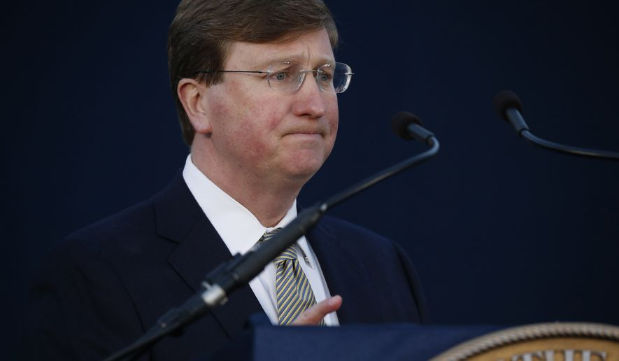 Gov. Tate Reeves pauses as he delivers his State of the State address before a joint session of the Legislature, seated outside the Capitol in Jackson, Miss., Monday, Jan. 27, 2020. (AP Photo/Rogelio V. Solis)