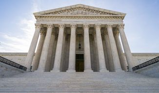 In this June 17, 2019, photo, The Supreme Court in Washington. A divided Supreme Court is allowing the Trump administration to put in place a policy connecting the use of public benefits with whether immigrants could become permanent residents. (AP Photo/J. Scott Applewhite) **FILE**