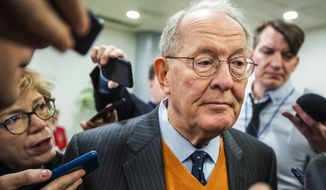 Sen. Lamar Alexander, R-Tenn., speaks to reporters as he arrives at the Capitol in Washington, Monday, Jan. 27, 2020, during the impeachment trial of President Donald Trump on charges of abuse of power and obstruction of Congress. (AP Photo/Manuel Balce Ceneta)