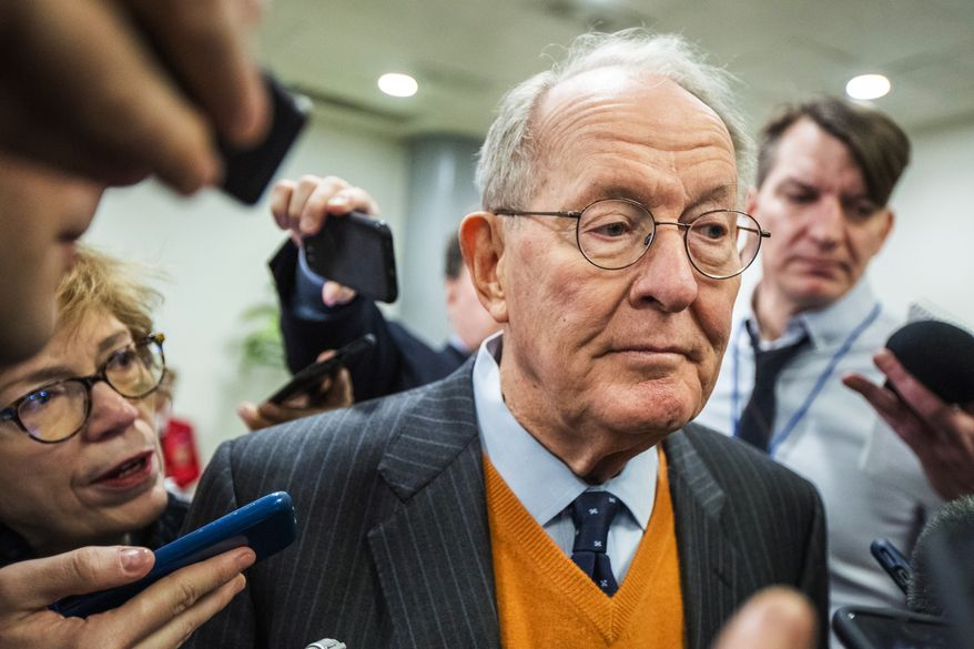 Sen. Lamar Alexander, R-Tenn., speaks to reporters as he arrives at the Capitol in Washington, Monday, Jan. 27, 2020, during the impeachment trial of President Donald Trump on charges of abuse of power and obstruction of Congress. (AP Photo/Manuel Balce Ceneta) ** FILE **
