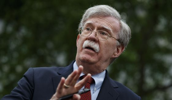 Then-National Security Adviser John Bolton talks to reporters outside the White House in Washington, May 1, 2019. (AP Photo/Evan Vucci)  ** FILE **