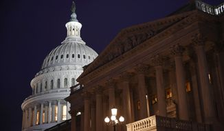 The Capitol is seen  in Washington, Monday, Jan. 27, 2020, during the impeachment trial of President Donald Trump on charges of abuse of power and obstruction of Congress. (AP Photo/Patrick Semansky)