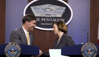 Secretary of Defense Mark Esper shake hands with French Minister of Armed Forces Florence Parly, at news conference at the Pentagon in Washington, Monday, Jan. 27, 2020. (AP Photo/Jose Luis Magana)