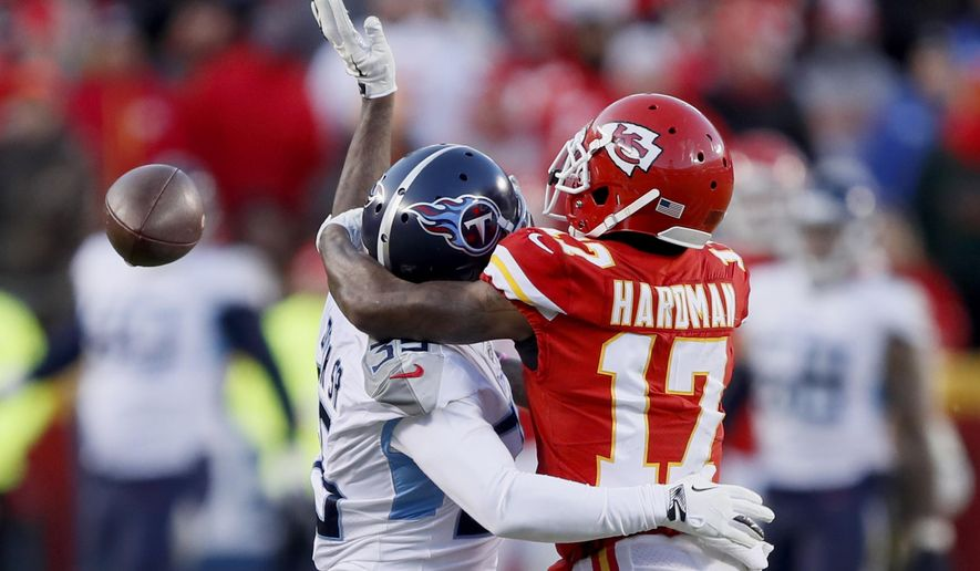 Tennessee Titans' Tramaine Brock is called for pass interference on a pass intended for Kansas City Chiefs' Mecole Hardman (17) during the second half of the NFL AFC Championship football game Sunday, Jan. 19, 2020, in Kansas City, MO. (AP Photo/Charlie Neibergall)